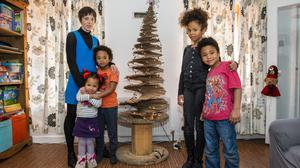 Annette Fuhrmann made her own Christmas tree with her children (l-r) Ayda (3) Sayid (8) Linda (10) and Malik (6). Photo: Douglas O'Connor