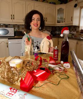 Hands on: Deirdre Reynolds gets stuck into her homemade Christmas presents Photo: Tom Conachy