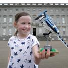 Using her block: Grace Connolly (7) with a bird made from Lego — always a firm favourite at Christmas