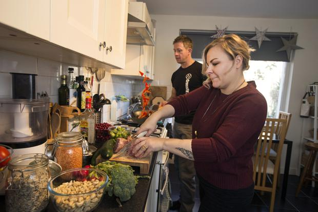 Veg out: Linda and Maciej prepare a dish