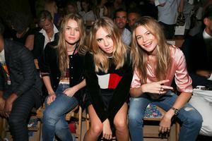 'I like doing something different' -  Guests on the all-important front row at Hilfiger's 2016 spring summer show; from left, Behati Prinsloo, model Suki Waterhouse and her sister Immy.
