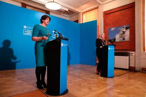 Escalation: First Minister Arlene Foster (left) and Deputy First Minister Michelle O'Neill during a press conference. The Stormont Executive announced this week that schools are to close for two weeks