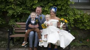 Sarah and Matthew Billingham with their two children, Logan and Darcie, on their wedding day last month. Photo: Emma May Loughran