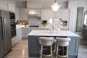 The kitchens came as standard in the new-builds but the owners were able to pick the colours of their units.  Nikki Cummins Black opted for light grey on top and dark grey beneath. The mirrored splashback was very much her own idea