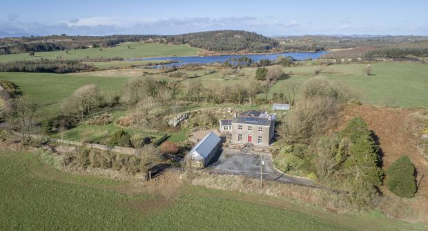 The spacious four double-bedroomed former country farmhouse offers magnificent views over the surrounding countryside towards the sea, with the thriving town of Tramore in the near distance