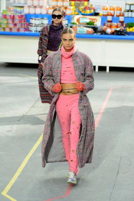 Cara Delevingne on the catwalk for Chanel during her modelling days