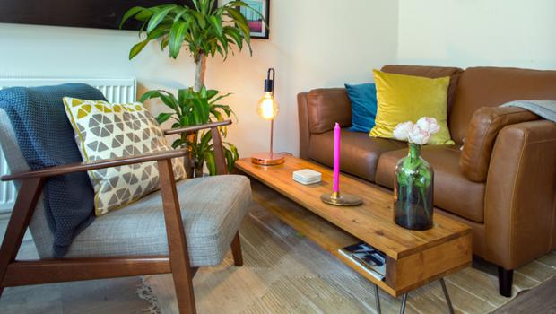 In the chilling area off the kitchen, the leather sofa is from Meadows and Byrne, one of Caroline's favourite shops, and the mid-century-modern-style chair is from Ikea. The plants throughout the house are flourishing, thanks to Barry
