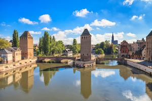 IMMERSED IN CULTURE: The medieval bridge Ponts Couverts and Cathedral in the old town of Strasbourg, capital of the Alsace region of France
