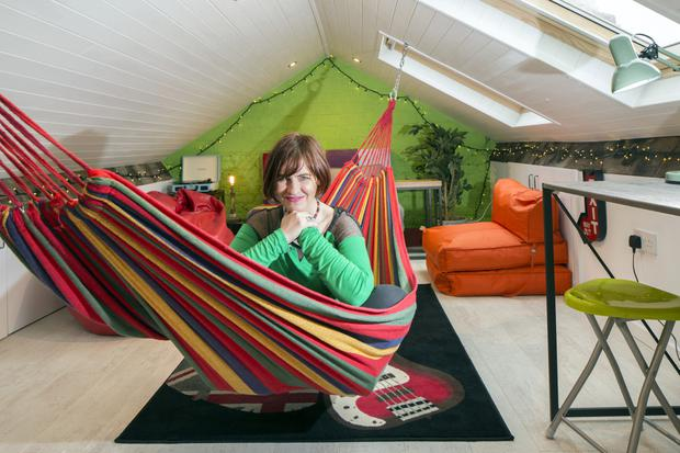 """Eleanor McEvoy in the colourful hammock in her converted attic. She gets inspiration for her songs up here, away from everything, with its views of the sky. """"I sleep in it a lot. I find it really soothing,"""" Eleanor says of the hammock"""