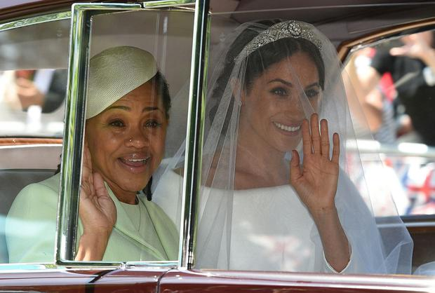Royal glitz: Meghan arriving for her wedding with her mother, Doria. Photo: Oli Scarff