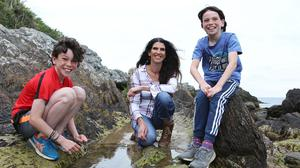 Pool sharks: Kathy Donaghy and her sons Dallan (far left) and Oirghiall at the rock pools during low tide at Shroove Beach in Inishowen, Co Donegal. Photo: Lorcan Doherty