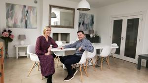 """The couple in their dining area. The paintings are by their friend, Lisa Woods. They brought the table and chairs from Australia. """"I wanted wood but Morgan wanted the white table. He doesn't usually have much of an input into the decor, so he got his way,"""" says Daphne top right: Morgan, Daphne and the four kids outside their lovely home in south county Dublin. """"My dad always said, 'If you're buying in an estate, buy the end house', so we did,"""" says Lisa"""
