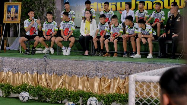 The 12 boys and their coach, Ekkapol Chantawong (left), from the Wild Boars soccer team speaking publicly for the first time after their rescue in July 2018