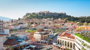 The square in Monastiraki, with vendors of hot nuts, squeaky toys, postcards and flags, is overlooked by the Acropolis