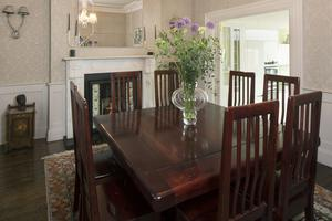 The formal dining room between the drawing room and the kitchen is home to a teak dining-room table and chairs