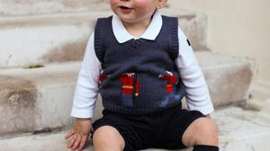 Prince George poses for his official Christmas photograph in 2014.