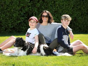 Slower pace: Writer Kate Gunn with two of her three children, sons Baxter (11) and Marley (13), and their dog Bonnie at their home in Greystones, Co Wicklow. Photo: Frank McGrath