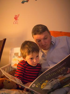 Graham Clifford reads bedtime stories for his son Aodhain (3) (pictured) Molly (8) and Aoife (6) which include members of their own family and past-times they are interested in