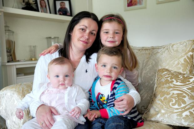 Joanne Fitzgerald and her children Luke 3, Mia 7 months, and Emma 6, at their home in Ballyfinn, Co Laois. Photo: James Flynn