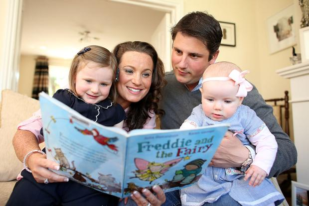 A world of pure imagination: Ian and Niamh Fortune read to their two daughters Cara ( 3) and Aoife (8 months) every night before bed.