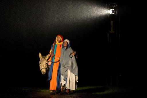 The inn crowd: A scene in which Joseph and Mary arrive at the Inn is depicted by actors at a Nativity play in England