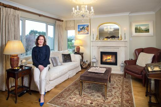 Patricia in her restful sitting room decorated in tones of cream. The mantelpiece and log fire were installed three years ago. Photo: Tony Gavin.