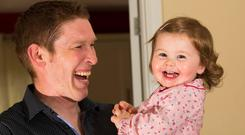 Time for hugs: Stay-at-home dad Benny Finlay with his 16-month-old daughter Bella in Kilmeaden, Waterford. Photo: Mary Browne