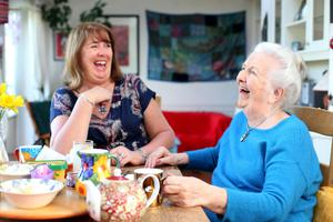 Sharing a laugh: Barbara Scully and her mother Noirin reflect on their parenting experiences over tea and cake