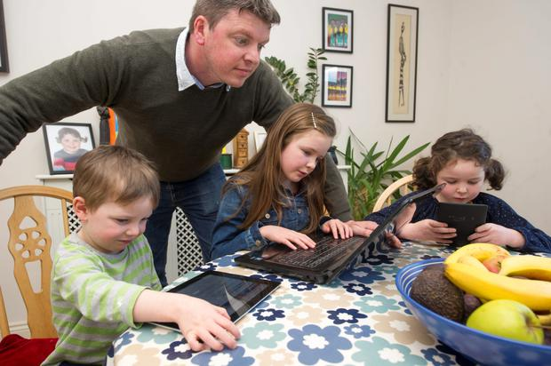 Eagle eyes: Graham Clifford monitoring the internet access of his children Aodhain (3), Molly (8) and Aoife (5)