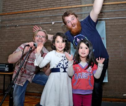 That's entertainment: Comic Steve Commons with Fiona Lee (5), Claire Lee (4) and Steve Bennett, comedian, taking part in Punchlion kid's show at last weekend's Five Lamps Arts Festival in Dublin. Photo: Maxwells