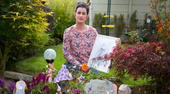 Niamh Connolly-Coyne holds a photograph of her baby daughter Mia at her garden memorial in her Celbridge, Co Kildare home. Photo: Colin O'Riordan