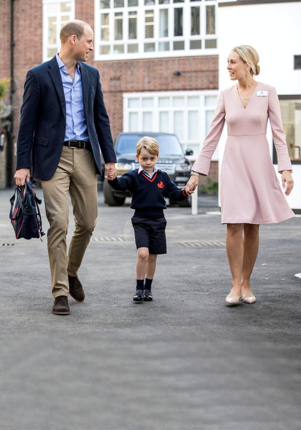 In safe hands: Prince William brings Prince George to school