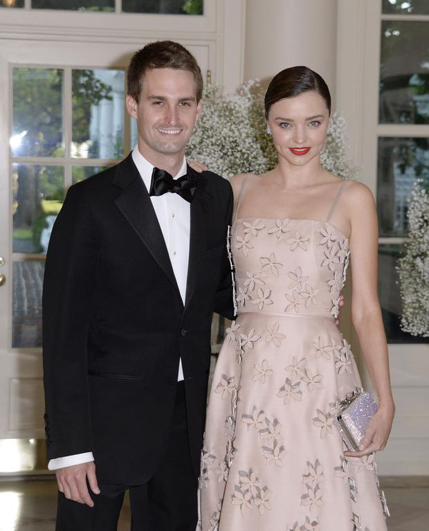Empowering his masculine: Miranda Kerr says she likes to spoil Evan Spiegel by wearing a dress and lighting candles