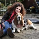 All dogs go to heaven: Karen Donoghue said the the arrival of her basset hound Barney helped her family get over the death of their old dog
