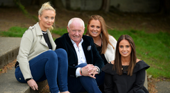 Paul Gallagher with his daughters (l-r) Sophie (22), Amy (29), and Kate (26) at Kilmacud Crokes GAA Club, Stillorgan. Photo: Caroline Quinn