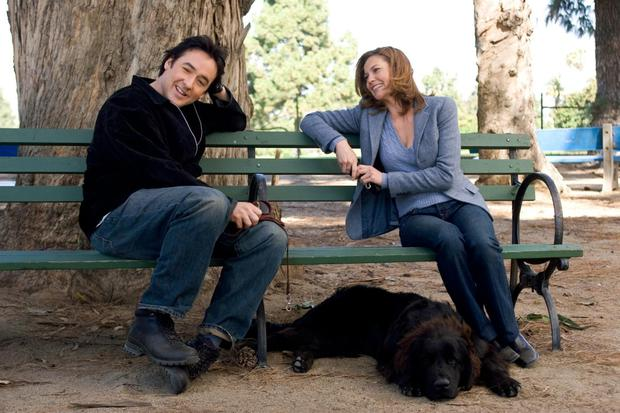 Woof love: John Cusack and Diane Lane bond over their love of dogs in Must Love Dogs