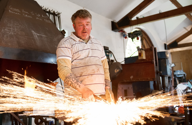 Hammer time: Stephen Quinn manipulates a piece of metal in his workshop in Kilreekil, Co Galway. Photo: Andrew Downes, xposure