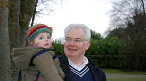 Campbell Spray carries his granddaughter Amy Jole in Phoenix Park during her first visit to Dublin.