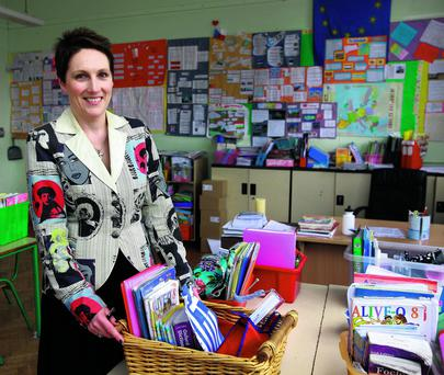 Top of the class: Carmel Hume, principal at Presentation Primary school in Terenure in Dublin, has a lot of administration work to deal with, but still manages to focus on the children.