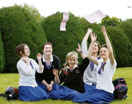 06/06/2013 Saoirse Hickey, Kim O'Shea, Aisling Enright, Orla Kennedy and Rachel Quinn throw their English Papers in the air after the second day of Leaving Certificate Examinations at Salesian Secondary School, Fernbank, Limerick. Pic: Don Moloney/Press 22