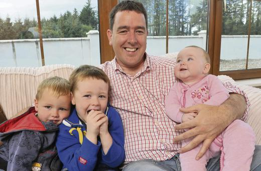 Family time: Thomas Byrne with his children Sinéad (5), Tomás (4) and Daithi (2)