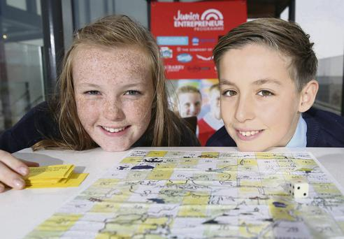 Game changers: Ailise Ryan (12) and David Fitzgerald (12), of Ardfert National School, with the board game created by their class during the Junior Entrepreneurs Programme