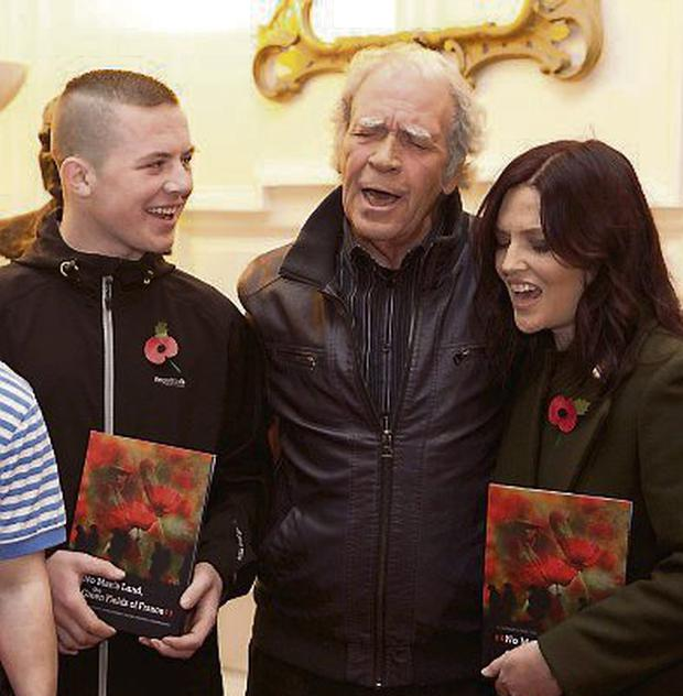 Finbar Furey at the launch of 'The Green Fields of France' with student Jamie Broughan and teacher Nora Kielty.