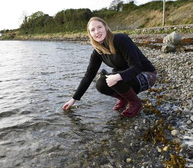 Yvonne Lang collects a sample from the sea near Renville, Co Galway