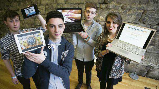 Thomas Mernagh, Thurles, Emmet Farrell, Drimnagh Castle and Adam O'Dwyer and Lia Grogan from Thurles, showcasing their work at the launch of Safer Internet Day