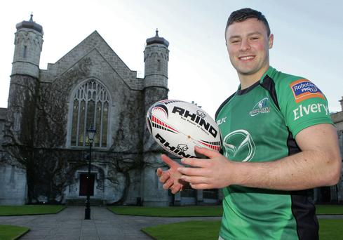 On the ball: Connacht Rugby player Robbie Henshaw is an Arts student at NUI Galway. Photo by Aengus McMahon