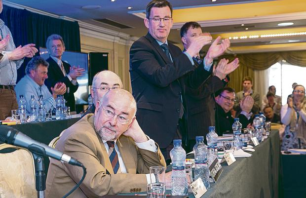 Ruairi Quinn watches while the TUI's Gerard Craughwell receives yet another standing ovation. Pat Moore