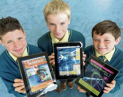 Hi-tech: first-year pupils at CBS Secondary School in Thurles Tom Ryan (13), Tom Clarke (14) and Peter Melbourne (13) with their iPad ebooks. Photo: Dylan Vaughan