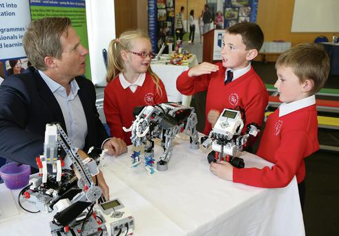 Rene Tristan Lydikse, managing director Lego Education Europe, with Leona Price (7), Calvin Ryan (8) and Conor Joyce (7) from St Michael's Infant School, CBS, Limerick.