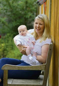 Nursing mum: Sinead with her three-month-old daughter Laoise
